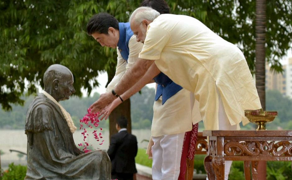 Dressed in a crimson Kurta, Abe, his wife and Modi then paid thier tributes to Mahatma Gandhi at the famed Sabarmati Ashram. PTI