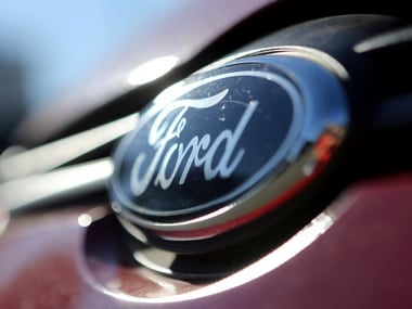 The Ford logo is seen on a car in a park lot. Reuters.