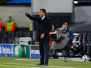 Feyenoord coach Giovanni Van Bronckhorst during Champions League match between Feyenoord and Manchester City. AP