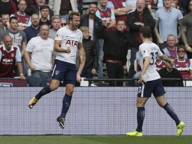 Tottenham's Harry Kane, left, celebrates after scoring his team's first goal, with teammate Ben Davies during the English Premier League soccer match between West Ham United and Tottenham Hotspur at the London Stadium in London, Saturday Sept. 23, 2017. (AP Photo/Tim Ireland)