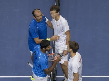 Canada's Daniel Nestor and Vasek Pospisil meet at the net with Rohan Bopanna and Purav Raja of India after their match. Reuters