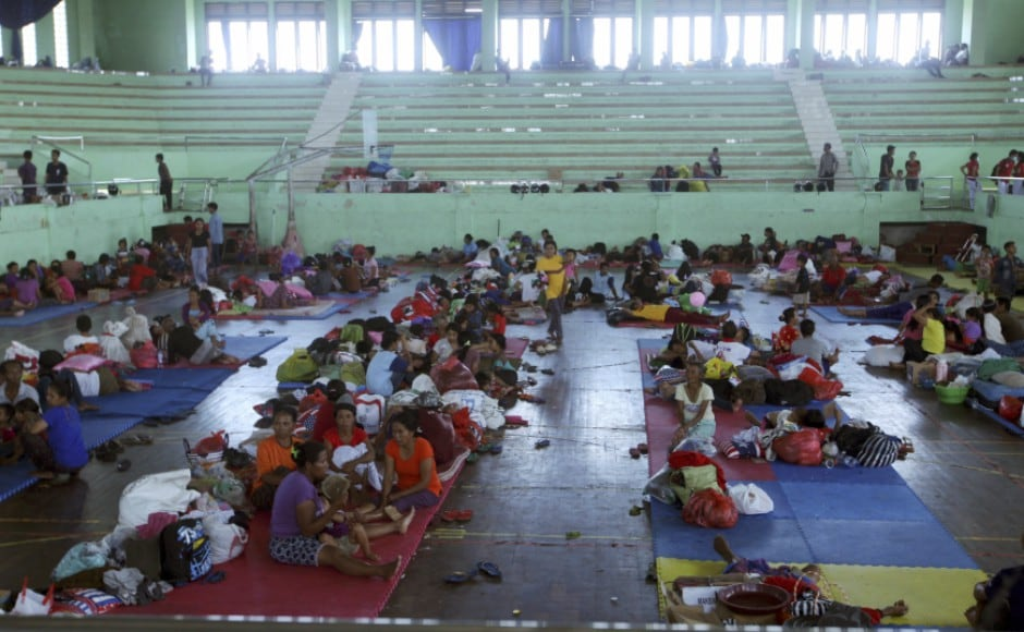 The people who have fled the volcano are scattered across Bali in more than 400 different locations, including temporary camps, sports centers and other public buildings. AP