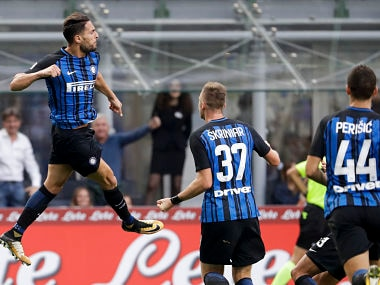 Inter Milan's Danilo D'Ambrosio, left, celebrates after he score during a Serie A soccer match between Inter Milan and Genoa, at Milan's San siro Stadium, northern Italy, Sunday, Sept. 24, 2017. (AP Photo/Luca Bruno)