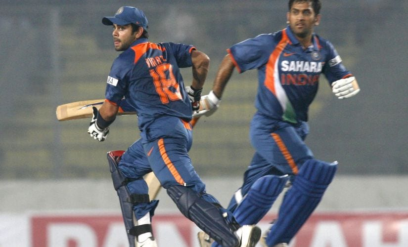 India's captain MS Dhoni (R) and Virat Kohli run between the wicket during the third one-day international cricket match of the tri-nations cricket series against Bangladesh in Dhaka January 7, 2010. REUTERS/Andrew Biraj (BANGLADESH - Tags: SPORT CRICKET) - GM1E6171R9301
