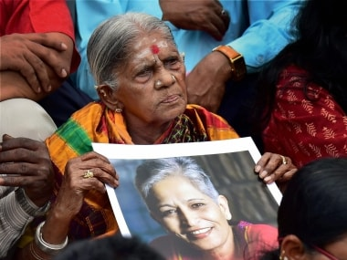 A supporter holding the photo of Gauri Lankesh during her funeral in Bengaluru. PTI