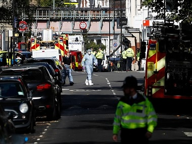 Police forensic officers near the site of the blast. AP