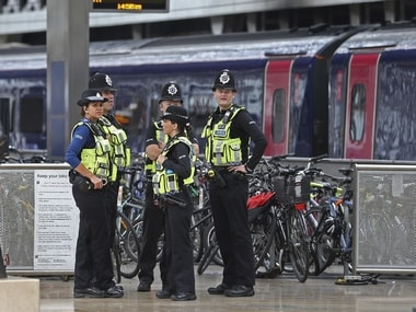 Police on vigil in London after the blast on Friday. AP