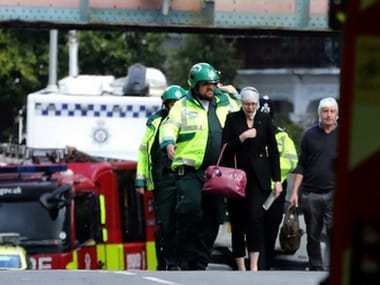 An injured woman is led away after an incident at Parsons Green underground station in London, on 15 September, 2017.  Reuters