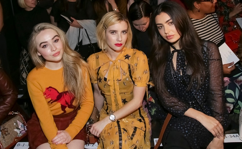 Sabrina Carpenter, Emma Roberts, and Charli XCX were seated together at the event, in the front row. Image from AP.