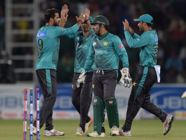 Pakistan players celebrate after a wicket in their second T20I against World XI. AFP