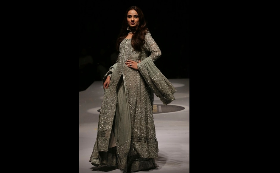 A model presents a creation by designer Adnan Pardase during the Pakistan Spring/Summer 2017 Fashion Show Week in Karachi, Pakistan, on Thursday, 14 September, 2017. Image courtesy: AP/Shakil Adil