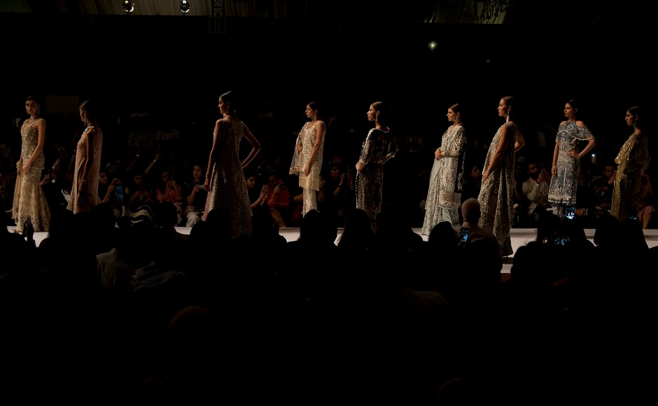 Models line up at the runway to show various creations by designer Saira Shakira during the Pakistan Spring/Summer 2017 Fashion Show Week in Karachi, Pakistan. Image courtesy: AP/Shakil Adil