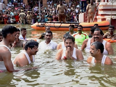 Tamil Nadu chief minister Palaniswami with ministers OS Manian and S Rajendran take a holy dip in the Cauvery river. PTI