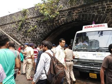 Police can be seen outside the Elphinstone Road station where a stampede took place on Friday. Aprameya Rao.