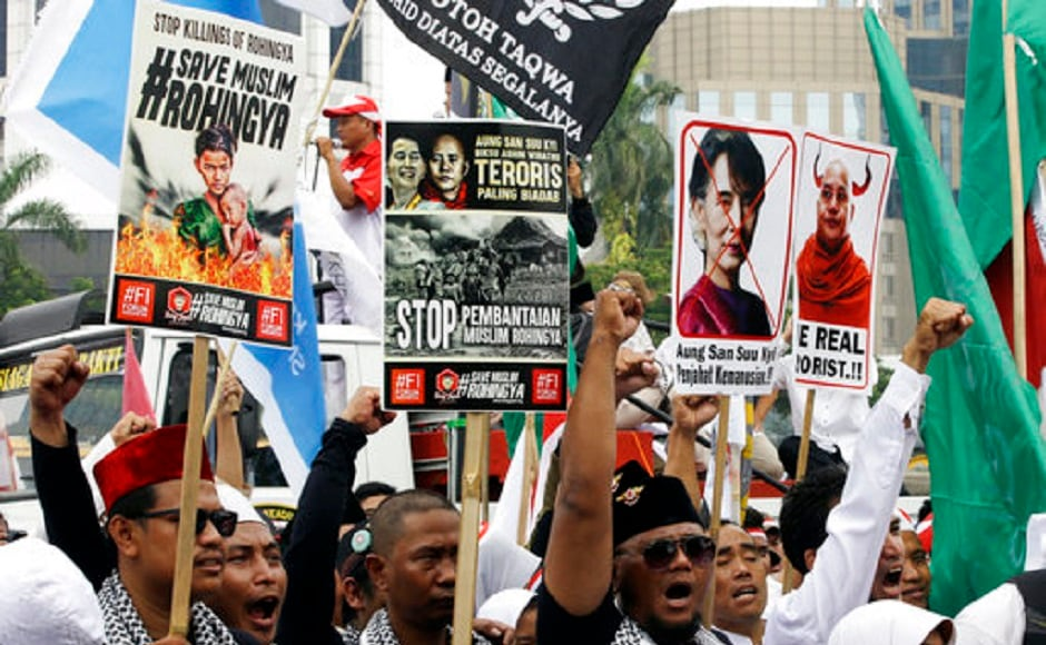 Protesters have been criticising Nobel Peace Prize laureate and Myanmar's de facto leader Aung San Suu Kyi and demanding her Noble prize to be revoked. AP