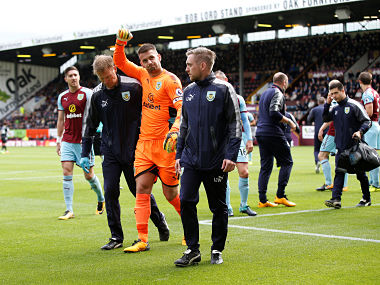 "Soccer Football - Premier League - Burnley vs Crystal Palace - Burnley, Britain - September 10, 2017 Burnley's Tom Heaton walks off to be substituted after sustaining an injury REUTERS/Andrew Yates No use with unauthorized audio, video, data, fixture lists, club/league logos or ""live"" services. Online in-match use limited to 75 images, no video emulation. No use in betting, games or single club/league/player publications. Please contact your account representative for further details. - RC14BAF321D0"