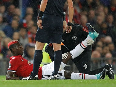 Soccer Football - Champions League - Manchester United vs FC Basel - Old Trafford, Manchester, Britain - September 12, 2017 Manchester United's Paul Pogba receives medical attention after sustaining an injury REUTERS/Darren Staples - RC13BC020130