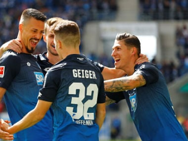 Soccer Football - Bundesliga - TSG 1899 Hoffenheim vs Hertha BSC Berlin - Rhein-Neckar-Arena, Hoffenheim, Germany - September 17, 2017 Hoffenheim's Sandro Wagner celebrates scoring their first goal with team mates REUTERS/Kai Pfaffenbach DFL RULES TO LIMIT THE ONLINE USAGE DURING MATCH TIME TO 15 PICTURES PER GAME. IMAGE SEQUENCES TO SIMULATE VIDEO IS NOT ALLOWED AT ANY TIME. FOR FURTHER QUERIES PLEASE CONTACT DFL DIRECTLY AT + 49 69 650050 - RC1AD8A13AD0