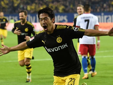 Soccer Football - Bundesliga - Hamburg SV vs Borussia Dortmund - Volksparkstadion, Hamburg, Germany - September 20, 2017 Borussia Dortmund's Shinji Kagawa celebrates scoring their first goal REUTERS/Fabian Bimmer DFL RULES TO LIMIT THE ONLINE USAGE DURING MATCH TIME TO 15 PICTURES PER GAME. IMAGE SEQUENCES TO SIMULATE VIDEO IS NOT ALLOWED AT ANY TIME. FOR FURTHER QUERIES PLEASE CONTACT DFL DIRECTLY AT + 49 69 650050 - RC1FE67911A0