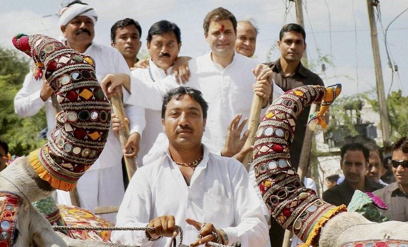 Rahul Gandhi rides on a bullock cart during a road show at Hanjadapar village in Dwarka district of Gujarat. PTI