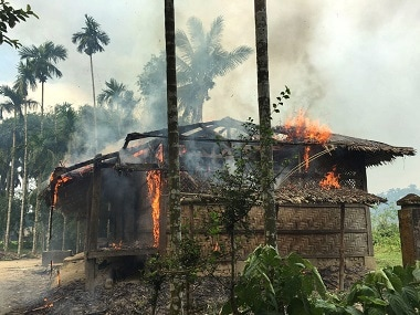A house in northern Rakhine catches fire. AP