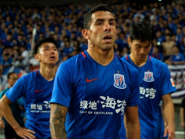 Shanghai Shenhua's Carlos Tevez walks to stands after losing the 2017 Chinese Super League football match between Shanghai East Asia (SIPG) FC and Shanghai Shenhua in Shanghai. AFP