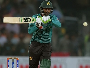 Shoaib Malik plays a shot during the first T20 against World XI. AFP
