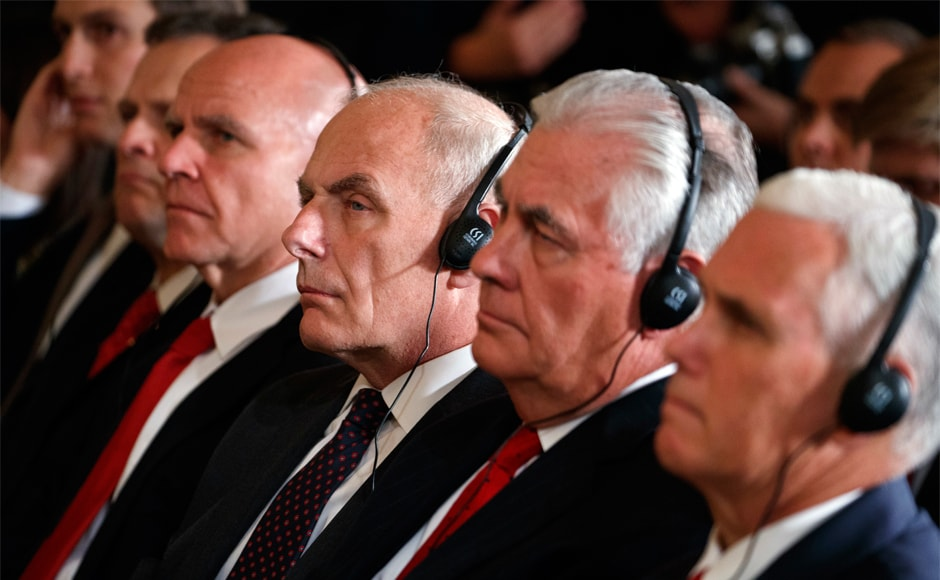 White House chief of staff John Kelly, third from right, listens during the press conference. Trump said he appreciated the emir's thus-far unsuccessful bid to end the dispute between Qatar and Saudi Arabia, the United Arab Emirates, Bahrain and Egypt. AP