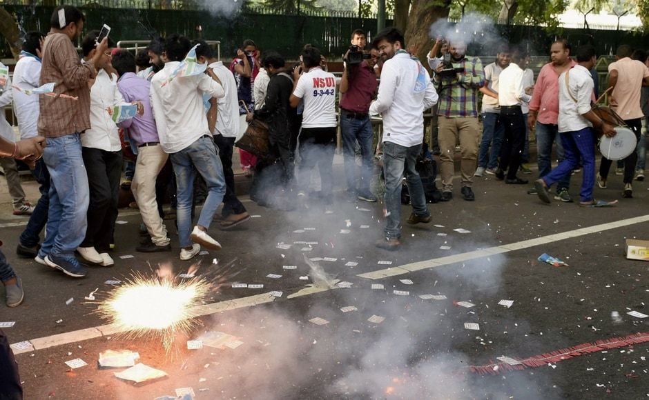 Supporters of NSUI celebrate outside 10 Janpath after their candidates' win in the much anticipated DUSU elections 2017.
