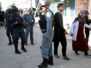 People leaving the site of the suicide attack in Kabul, Afghanistan. AP