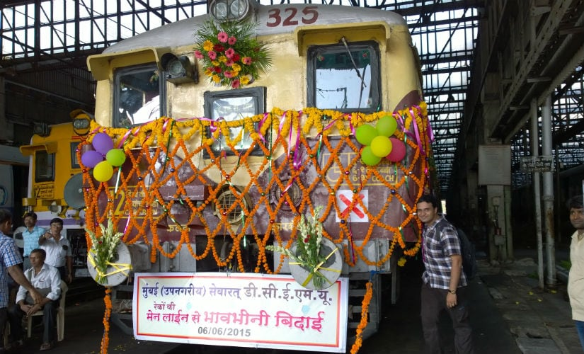 Railfans pose for photograph while decorating the last DC EMU. After Central Railways decided to switch traction from Direct Current (DC) to Alternate Current (AC) railfans got the opportunity to decorate the last DC EMU. Photo credit: Vijay Arvadhuman