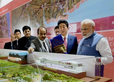Prime Minister Narendra Modi with his Japanese counterpart Shinzo Abe at Ground Breaking ceremony of Mumbai-Ahmedabad High Speed Rail Project, in Ahmedabad on Thursday. Union Minister for Railways and Coal, Piyush Goyal is also seen. PTI Photo/ pib(PTI9_14_2017_000028B) *** Local Caption ***