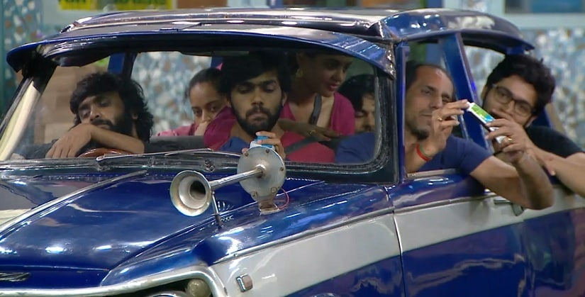 The contestants perform the 'Who's Inside the Car?' task on Week 12 of Bigg Boss Tamil
