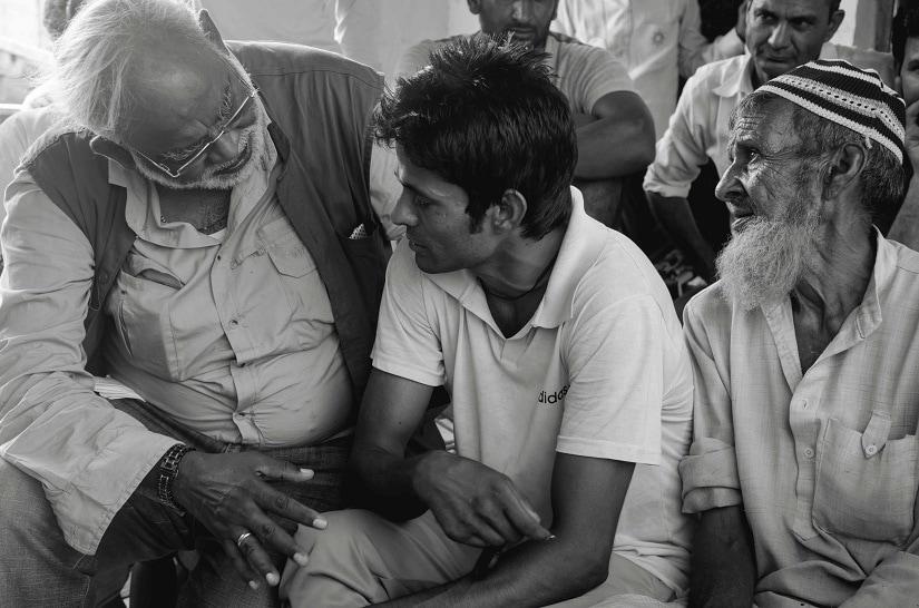 Human rights activist and Karwan member John Dayal with Jaffruddin and his younger son