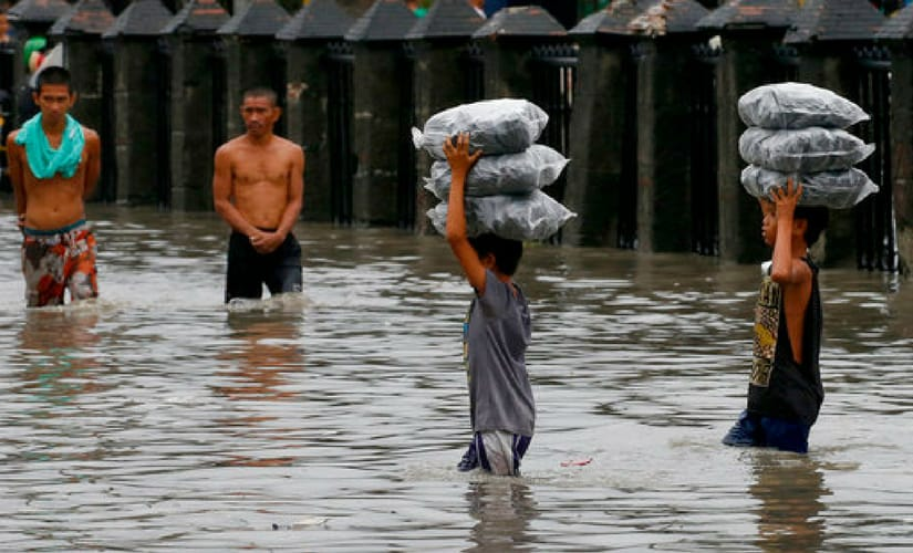 Five other people remain missing after flash floods swept away a house beside a swollen river in Laguna province, disaster relief officials said. AP