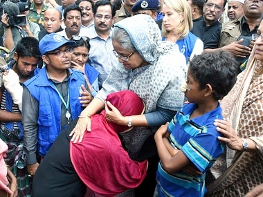 Sheikh Hasina meets Rohingya Muslims at a refugee camp. AP