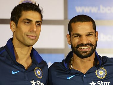 Indian cricketers Ashish Nehra (L), Shikhar Dhawan (C) and Pawan Negi pose for a photograph during a press conference ahead of the forthcoming Asia Cup tournament in Kolkata on February 21, 2016. AFP PHOTO / Dibyangshu SARKAR / AFP PHOTO / DIBYANGSHU SARKAR