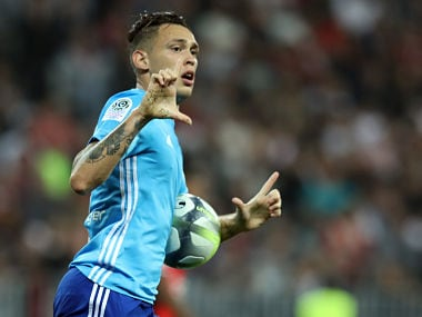 "Olympique de Marseille's Argentinian forward Lucas Ocampos celebrates after scoring a goal during the French L1 football match Nice vs Marseille on October 01, 2017 at the ""Allianz Riviera"" stadium in Nice, southeastern France. / AFP PHOTO / VALERY HACHE"