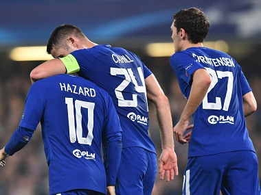 Chelsea's Eden Hazard (L) celebrates after scoring his second goal of the game against AS Roma in the Champions League. AFP