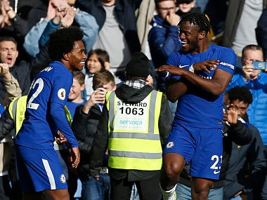 Michy Batshuayi (R) celebrates his second, and the team's fourth goal during their English Premier League match against Watford. AFP