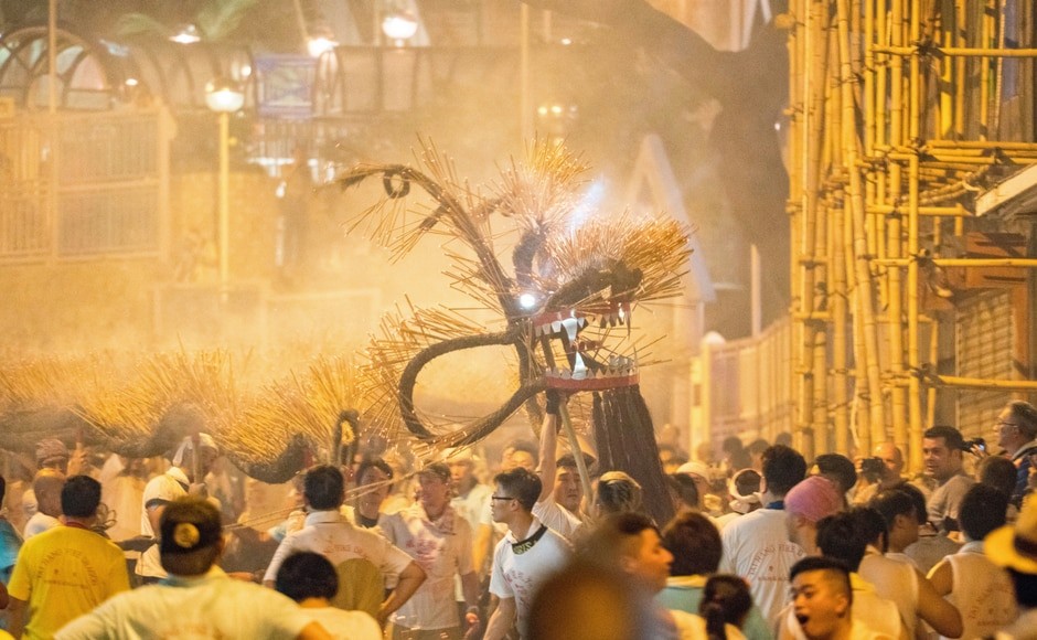 Among the most splendid of all festive activities, is the Tai Hang Fire Dragon Dance with over 70,000 sticks of burning incense in which around 300 people participate in a dance. AP