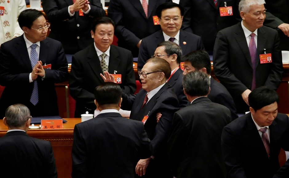 Former Chinese president Jiang Zemin (C) waves as he leaves after the opening session of the Congress at the Great Hall of the People in Beijing. Reuters