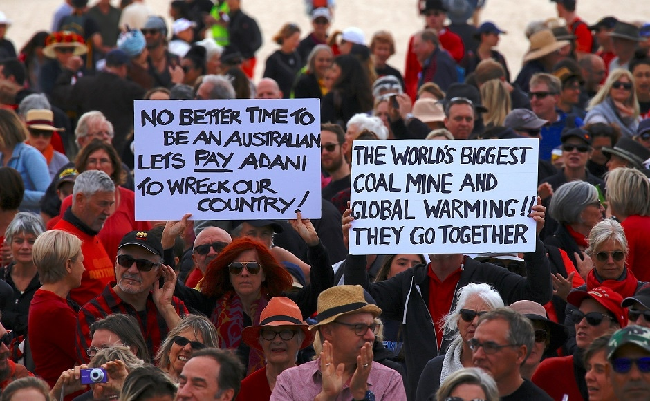 More than 1,000 people formed a human chain shouting 'Stop Adani', on the sands of Sydney's Bondi Beach. Reuters