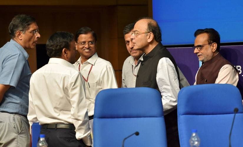 Union finance minister Arun Jaitley with top officials of his ministry after a press conference at National Media Centre in New Delhi on Tuesday. PTI