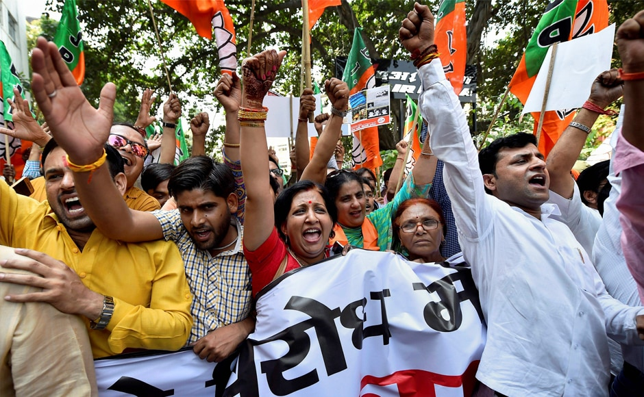 Delhi BJP workers participate in the Janaraksha Yatra to protest against against the alleged killing of RSS and BJP workers in the state of Kerala, in New Delhi on Monday. PTI