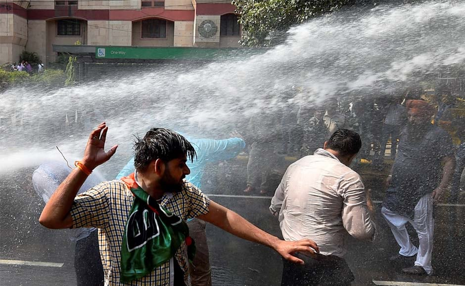 Police disperse crowds with water cannons. After Amit Shah on Sunday, Union ministers Kiren Rijiju and General VK Singh led the rally for BJP on Monday. PTI