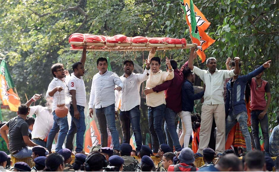 Partyworkers take out a mock funeral procession of the Kerala government during their Janaraksha Yatra outside the CPM office in New Delhi. PTI