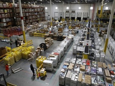 Workers prepare to move products at an Amazon fulfillment center in Baltimore. Image: AP Photo/Patrick Semansky