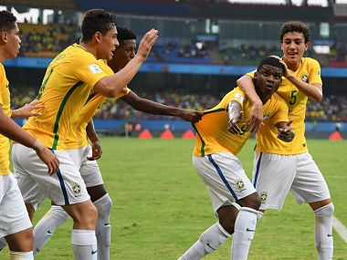 Image of Brazil U-17 football players celebrating a goal during their clash with Spain. Getty Images