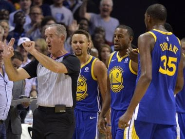 Referee Scott Wall, left, calls Golden State Warriors guard Stephen Curry (30) for a foul on Saturday. AP